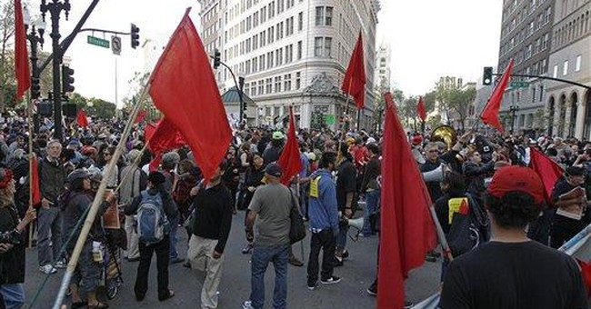 Stinging gas sends May Day protesters fleeing